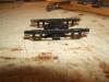 Gurte unterhalb der Achslagerführungen sind ergänzt, die ansonsten fast niemals zu finden sind, zumindest nicht bei gefederten Drehgestellen!